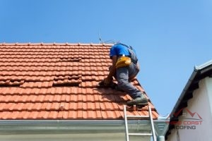 Roof Tiles Being Replaced by a Roofer.